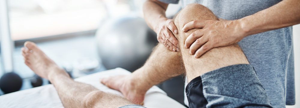 Closeup shot of an unrecognizable physiotherapist treating a patient